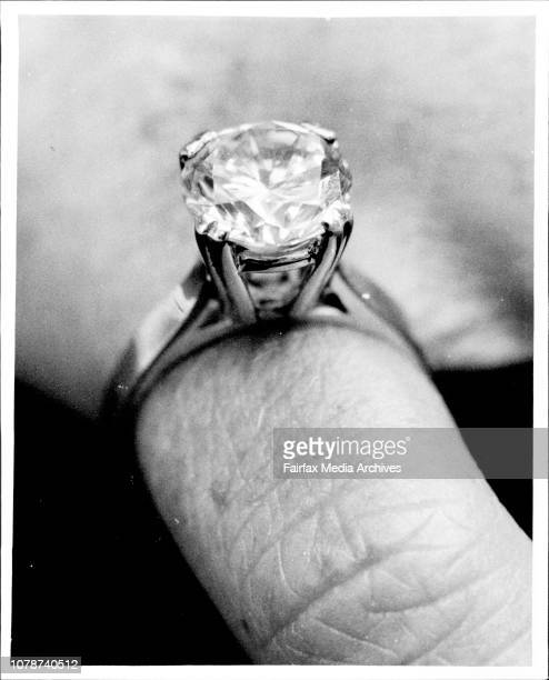 A Police woman shows a replica of the ring taken from the room of murdered Jill Reynette Holford defacto to William Graf Its a ladies solataire...