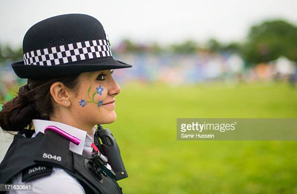 Police woman wears face paint on the Glastonbury Festival of Contemporary Performing Arts at Worthy Farm Pilton on June 27 2013 in Glastonbury England