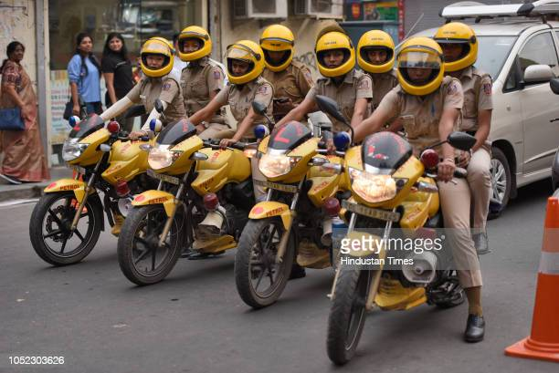 A police women patrolling squad patrols at Khan Market on October 16 2018 in New Delhi India