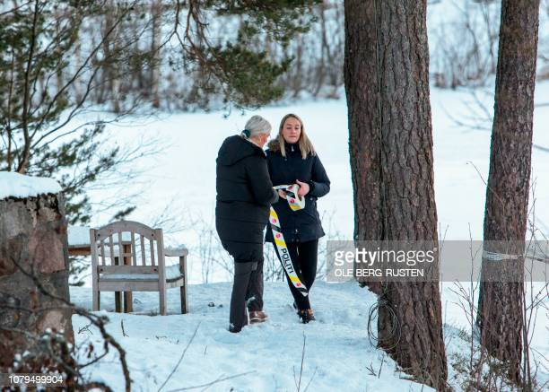 Police women work outside of the house of of Norwegian multimillionaire Tom Hagen in Fjellhamar East of Oslo on January 9 2019 as his wife...