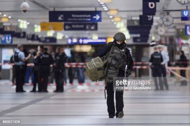TOPSHOT Police work at the scene at the main train station in Duesseldorf western Germany after at least five people where injured by a man with an...