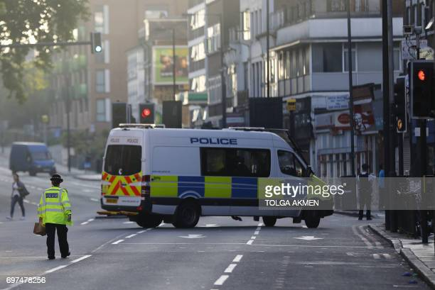 Police work at the scene in Finsbury Park area of north London after a vehichle hit pedestrians on June 19 2017 One man was killed and eight people...