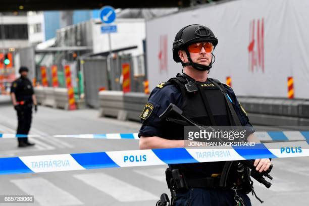 Police work at the scene where a truck crashed into the Ahlens department store at Drottninggatan in central Stockholm April 7 2017 PHOTO / Jonathan...