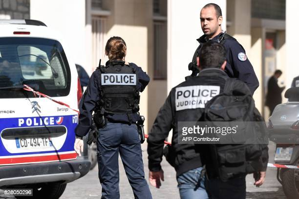 Police work at the site where a car slammed into soldiers on patrol in LevalloisPerret outside Paris on August 9 2017 A car slammed into soldiers on...