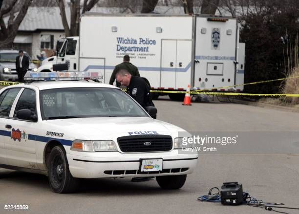 Police work in front of the house that Dennis Rader lives in February 26 2005 in Park City Kansas Rader is the suspect whom police have arrested on...