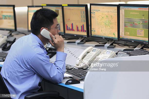 Police work in the alarm center at the Beijing traffic Police Command center on May 12 2011 in Beijing China The Beijing Traffic Management Bureau...