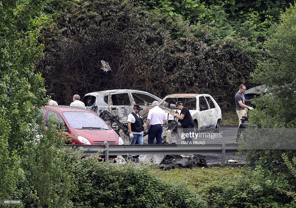 Police Work Next To The Wreckage Of A Car Owned By Spanish Policeman