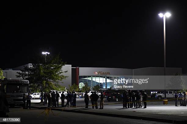 Police work outside of the Grand Theatre on July 23, 2015 in Lafayette, Louisiana. Three people are dead and seven more injured after a gunman opened...