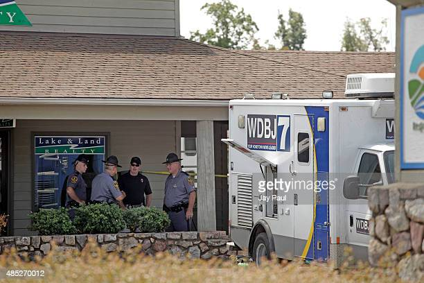 Police work the crime scene at Bridgewater Plaza on Smith Mountain Lake on August 26 2015 in Moneta Virginia Two employees of WDBJ TV were killed...