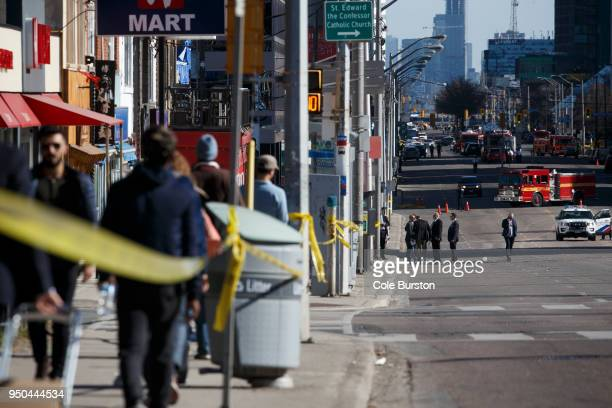 Police work the scene on Yonge St at near Finch Ave after a van plowed into pedestrians on April 23 2018 in Toronto Canada A suspect identified as...