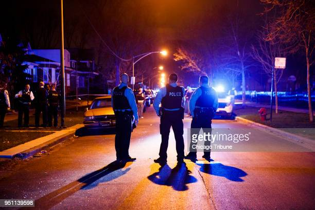 Police work the scene where two people were shot near the intersection of 60th and Maplewood Avenue Tuesday April 24 2018 in Chicago