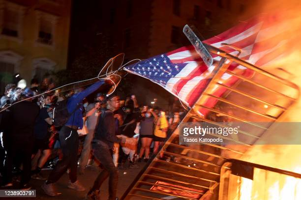 Police work to keep demonstrators back during a protest on May 31 2020 in Washington DC Across the country protests were set off by the recent death...