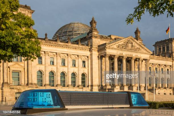 Policecar in front of the Reichstag (german parliament building) - Berlin, Germany