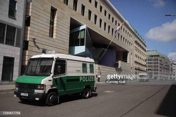 Policecar stays outside the British Embassy on August 11, 2021 in Berlin, Germany. German law enforcement authorities announced today that they have...