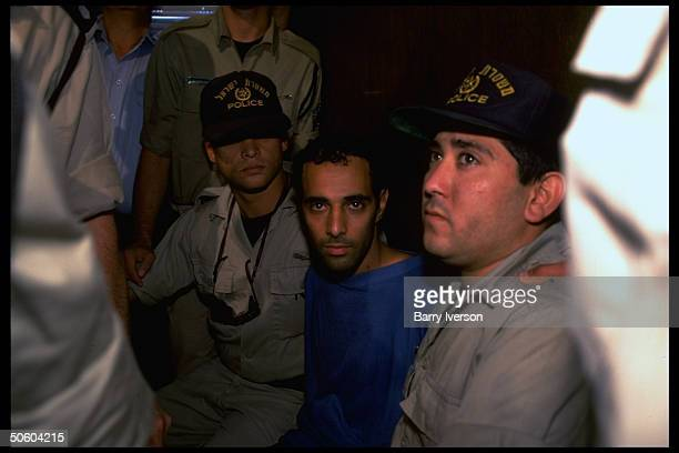 Police-flanked assassin Yigal Amir in court, being arraigned for murder of PM Yitzhak Rabin.