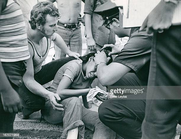 AUG 2 1973 AUG 3 1973 A policeman aids Jennifer Mergeron of 572 Bryant St after her bicycle and a car collided about 7 pm Thursday at W 9th Ave and...