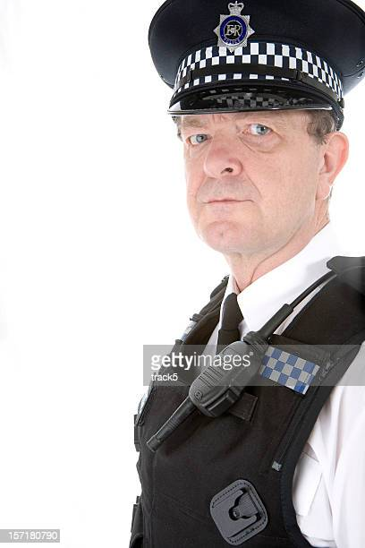 uk policeman: an authoratative glance from a uniformed british cop - metropolitan police stock pictures, royalty-free photos & images