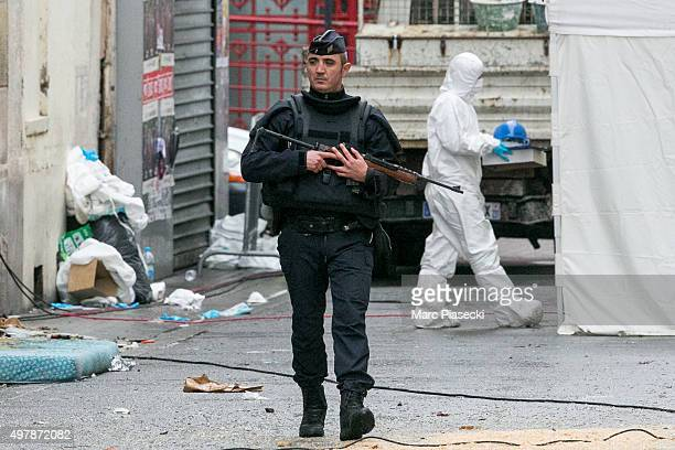 A policeman and forensics of the french police works in front of the '2 Rue du Corbillon' on November 19 2015 in SaintDenis France France continues...