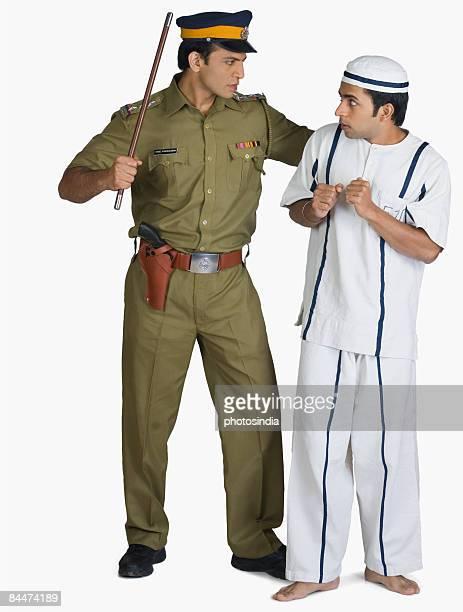 Policeman arresting a prisoner