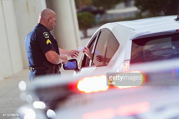 policeman asking a driver for identification - traffic examining stock pictures, royalty-free photos & images
