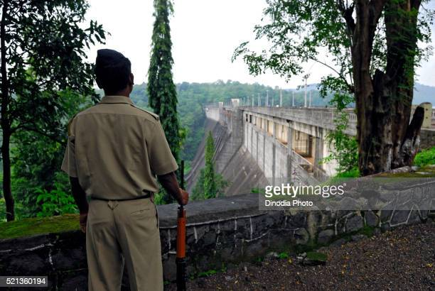 Policeman at vaitarna dam, Maharashtra, India