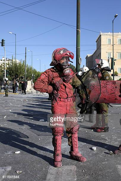 Policeman attacked with color bombs during demonstrations in Athens, Greece, Oct 19, 2011. On the first day of a 48hr general strike over 100.000...