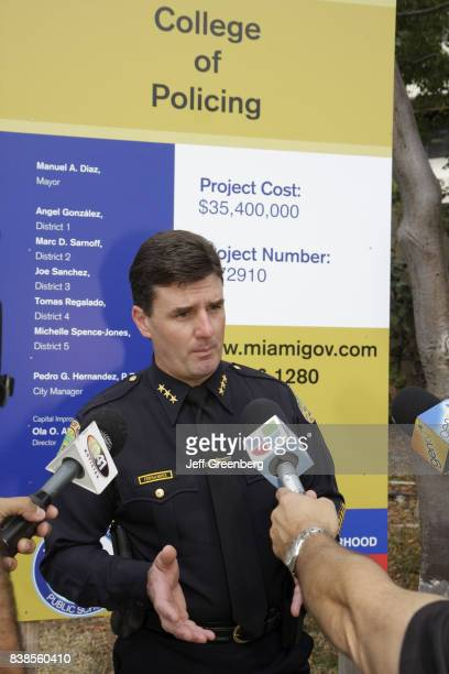 A policeman being interviewed at the groundbreaking ceremony for the College of Policing