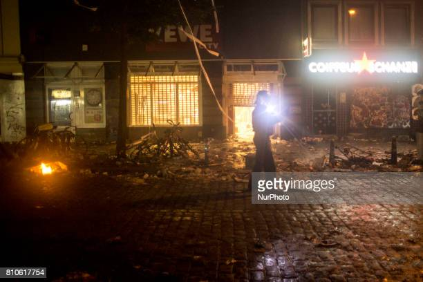 Policeman check the area during riots in St Pauli district during G 20 summit in Hamburg on July 8 2017 Authorities are braced for largescale and...