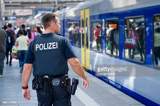 A policeman checks a train that arrived from Austria at Munich Hauptbahnhof main railway station on September 1 2015 in Munich Germany Over a...