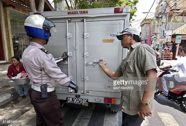 Policeman checks a van for explosives one day before the second anniversary of the Bali bombing in Kuta Bali 11 October 2004 Indonesia on Tuesday...
