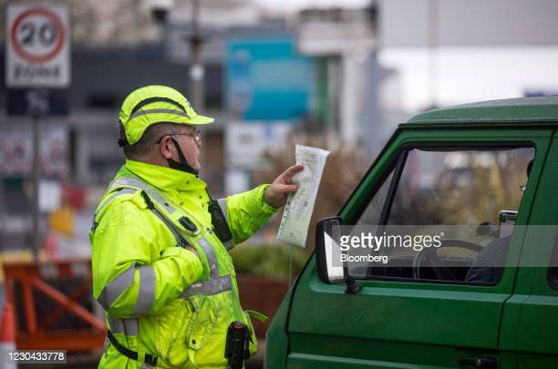 Policeman checks the paperwork of a driver before allowing them to enter the Port of Dover Ltd. In Dover, U.K., on Tuesday, Jan. 5, 2021. The lack of...