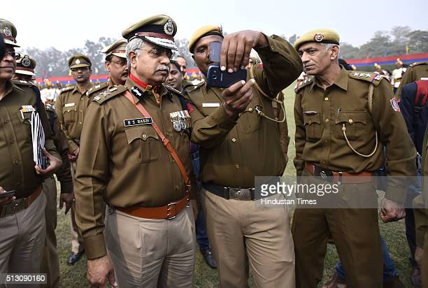 A policeman clicking a selfie with outgoing Delhi Police Commissioner BS Bassi during his Farewell Parade at Parade Ground New Police Lines Kingsway...
