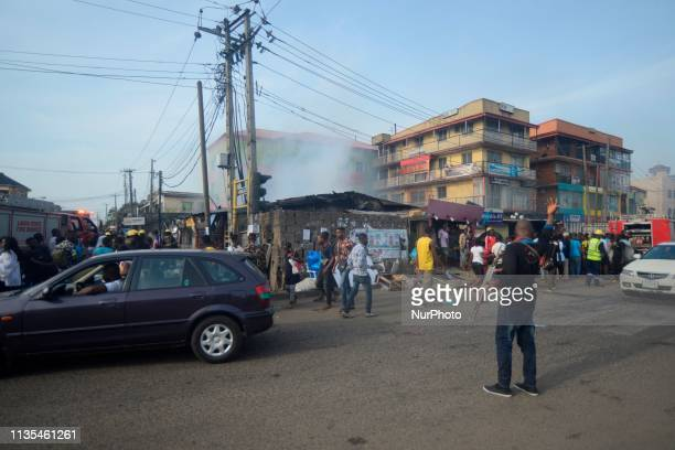 Policeman controls traffic at Ogba in Lagos Nigeria where fire razed several shops on Saturday April 6 2019 Photo by Adekunle Ajayi