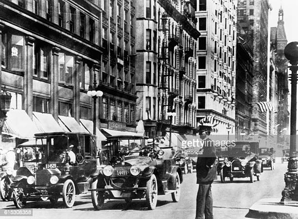 Policeman directing downtown Chicago traffic ca 1917