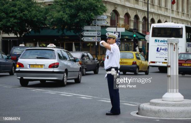 Policeman directing traffic near Notre Dame.