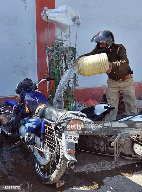 A policeman dousing the motorbike on fire during clash between lawyers and police after a police official shot dead a lawyer and injured another...