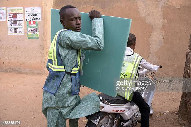 A policeman drives on March 28 2015 an official of the Independent National Electoral Commission to a polling station in Gidan Niyam Sakin Yara in...