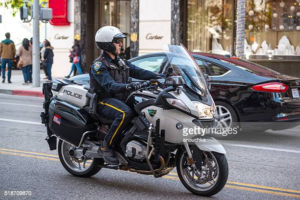 Policeman driving Motorcycle on Rodeo Drive, Beverly Hills