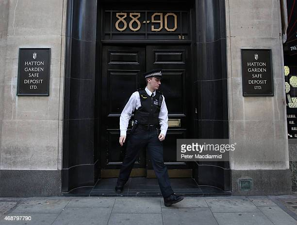 Policeman emerges from a Hatton Garden safe deposit centre on April 7, 2015 in London, England. Police are investigating a break in that occured over...