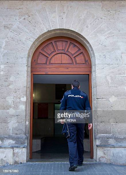 A policeman enters the courthouse in Palma de Mallorca on the Spanish Balearic Island of Mallorca on February 24 where King Juan Carlos' soninlaw...