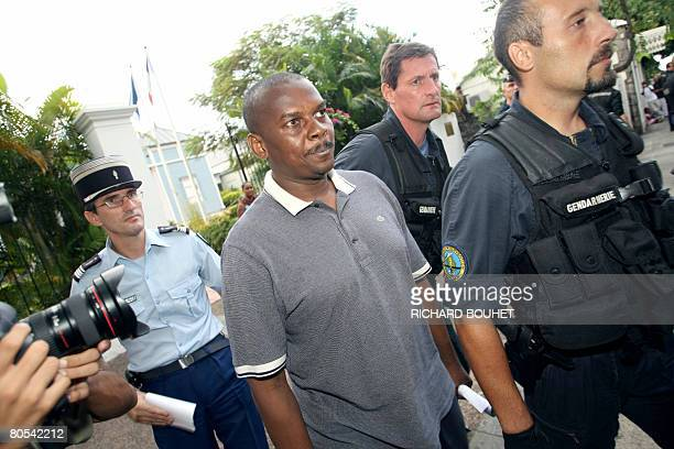 Policeman escort ousted leader of the Comoros island of Anjouan Mohamed Bacar upon his arrival at the Administrative court on April 6 2008 in...