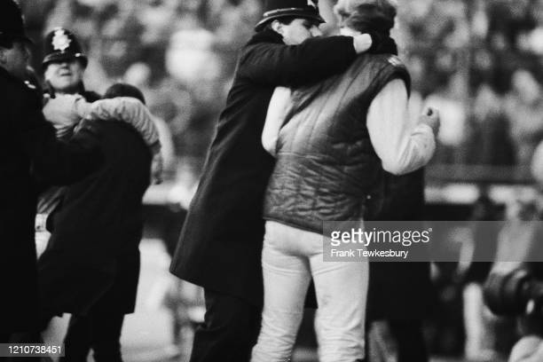 Policeman escorting a fan during the FA Cup Fourth Round match between Leyton Orient and Southampton at Brisbane Road in London, England, 26th...