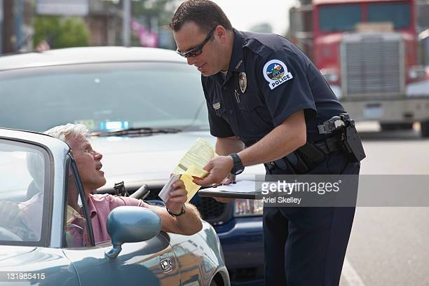 Policeman giving driver traffic citation