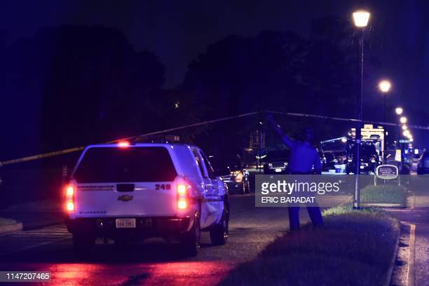 A policeman grants access to a forensic truck at the Virginia Beach municipal center the site of a mass shooting in Virginia Beach Virginia in the...