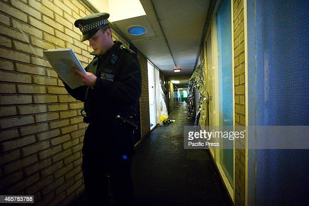 A policeman guarding the crime scene all residents of the housing estate has to be registered to enter the building A man was stabbed to death at 73...