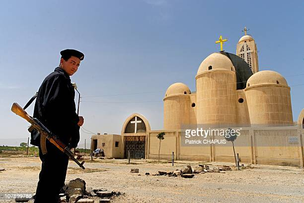 Policeman guards a Coptic church in El-Arish, Egypt on April 19, 2006. Egyptian authorities have increased security January 6, 2011 as Coptic...