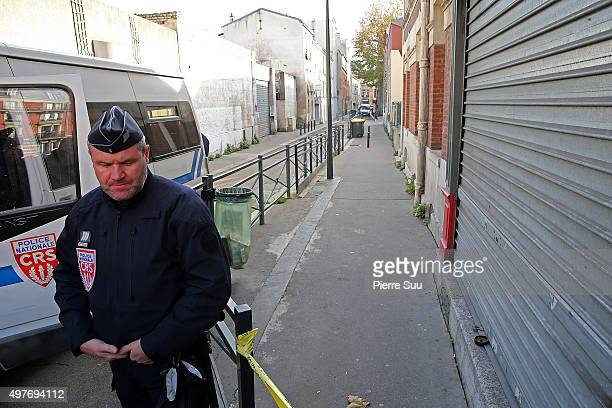 Policeman guards an area of Rue des Corbillon in the northern Paris suburb of Saint-Denis following a raid on an apartment on November 18, 2015 in...