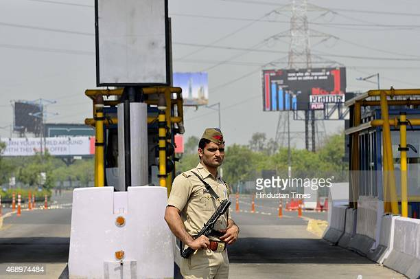 A policeman guards during BJP workers staged a protest demonstration at the DelhiNoida Direct Flyway demanding scrapping of the toll plaza on April 8...