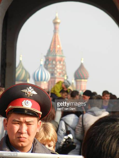 Policeman guards the entrance to Moscow's Red Square, with the cathedral in the back.