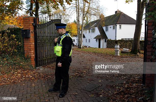 A policeman guards the entrance to the home of comedian Freddie Starr on November 2 2012 in Studley England Comedian and television personality...